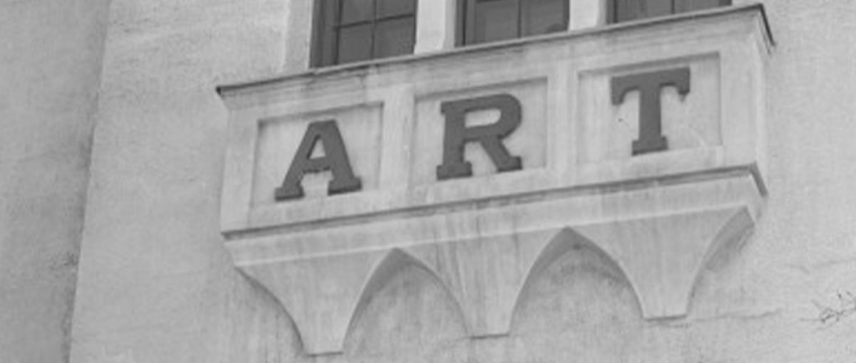 "A sign on a building that reads, ""ART."""