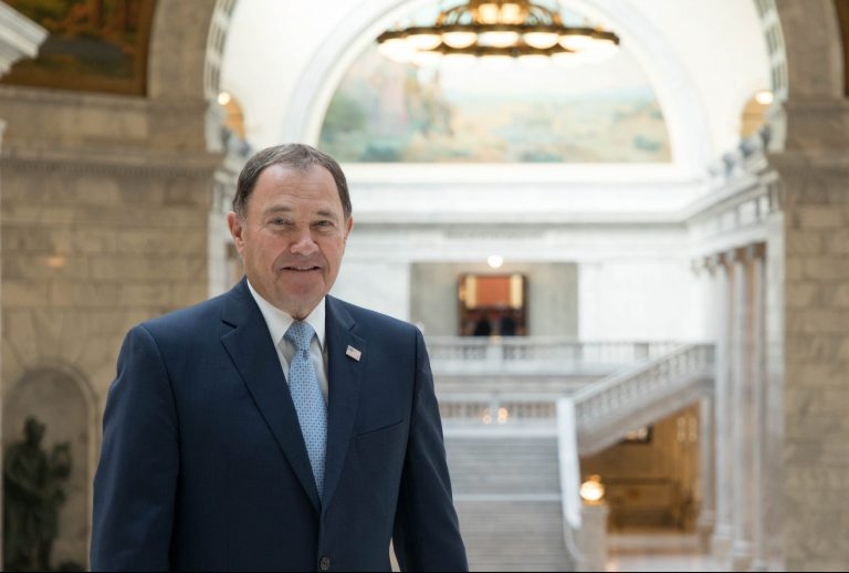 A portrait of former Utah Governor Herbert in the state capitol.