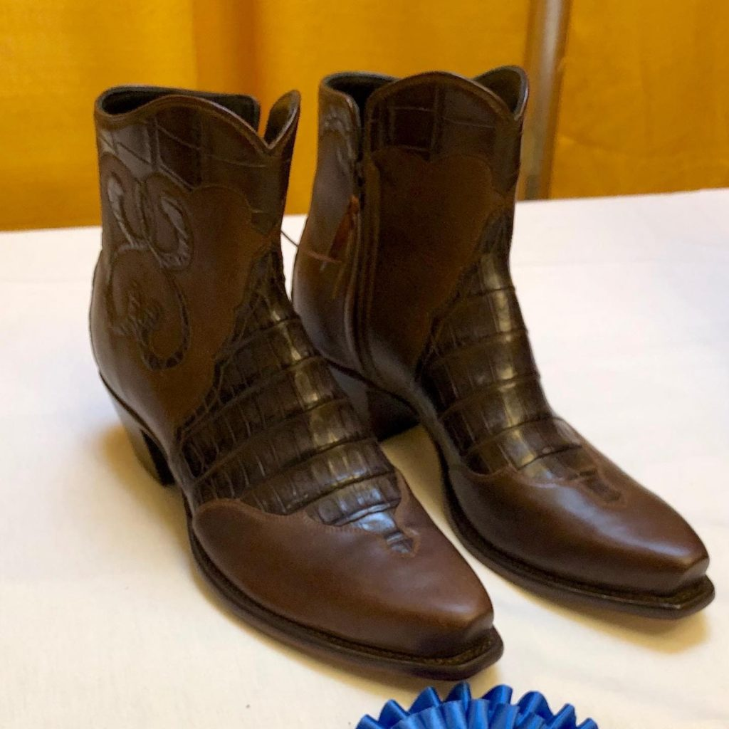 A pair of brown cowboy boots